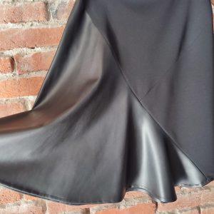 Black asymmetrical skirt in eco leather